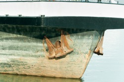 Detail of moored transport boat with prow and anchor close up