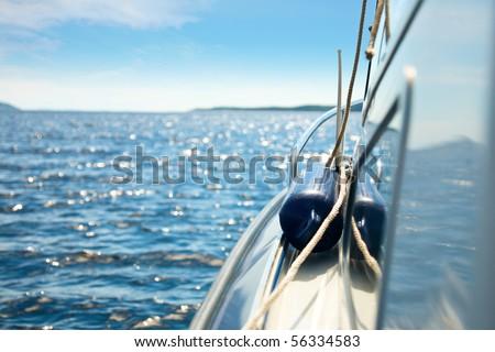 Detail of motor boat cruising in the sea