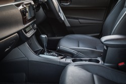 Detail of new modern car interior, Focus on hand break
