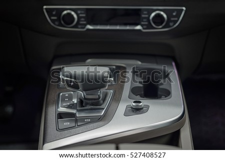 Detail of new modern car interior. Focus on shift lever. #527408527
