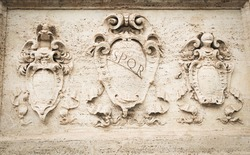 Detail of old basrelief in Roma, Italy