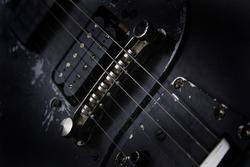 detail of old black guitar