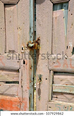 Detail of old blue shabby door of the abandoned house in Greece