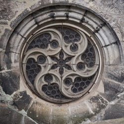 Detail of old gothic cathedral round window in Europe