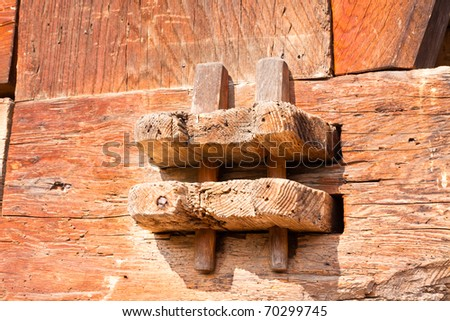 Detail of old hand-crafted wooden joint on historic Black Forest farmhouse, Germany.