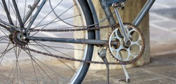 detail of old ruined bicycle, with rusty chain