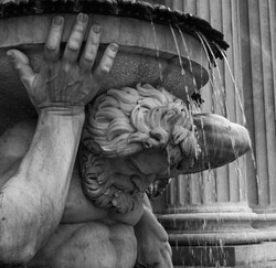 Detail of one of the figures at the base of the Albrechtsbrunnen (also known as Danubiusbrunnen) fountain outside the Albertina Museum in Vienna, built in 1864. Toned.