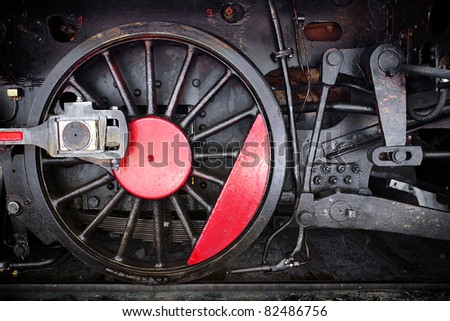Detail of one wheel of a vintage steam train locomotive