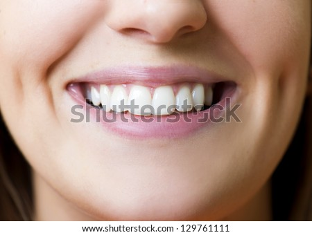 Detail of perfect and white smiling teeth