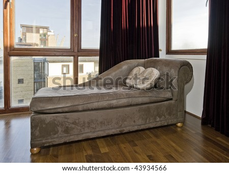 stock photo : detail of psychiatrist sofa in a room with floor to ceiling