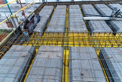 Detail of reinforced concrete slab with lightweight concrete blocks under construction