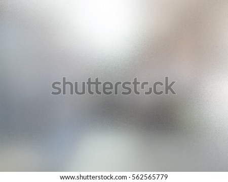 detail of sand glass window with blurred background behind #562565779