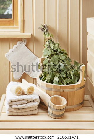 Detail of sauna interior with traditional sauna accessories