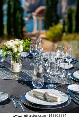 Detail of served dinner table for outdoor event.