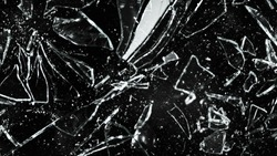 Detail of shattered glass on black background. Texture of broken glass.