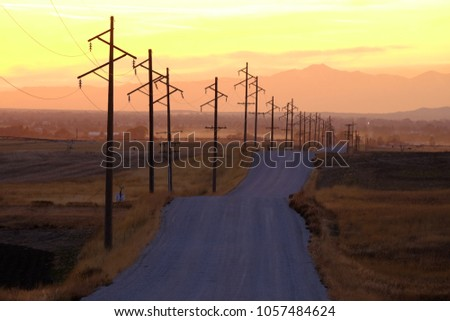 Detail of Silhouetted power lines phone lines at sunrise or sunset silhouette