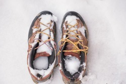 Detail of snowy sports shoes.  Forgotten shoes in the snow. Winter compilation.
