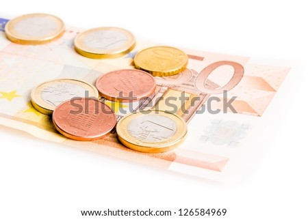 detail of some money euro coins on 50-euro banknote on white background