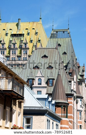 Detail of some victorian houses and the historical Chateau Frontenac in old Quebec City - stock photo