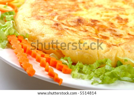 Detail of spanish omelette with vegetables
