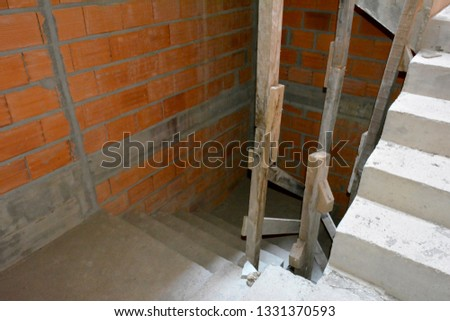 Detail of staircase construction between floors of apartments in the rough with visible structure without coverings or protections #1331370593
