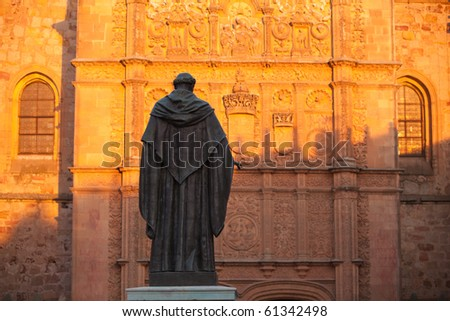 Detail of statue and Salamanca cathedral, Spain.