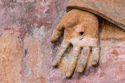 detail of statue with hand with the stigmata
