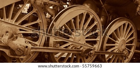 detail of steam locomotive wheels - stock photo
