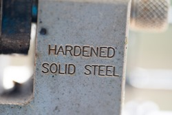 detail of steel padlock with the inscription
