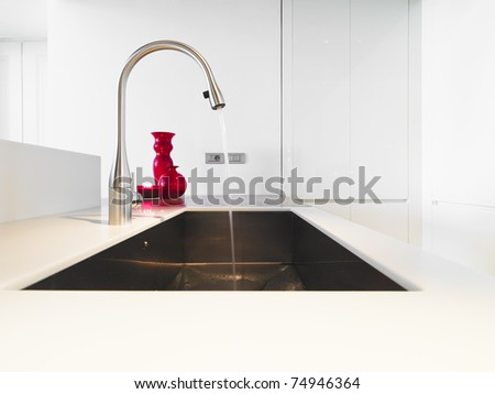 detail of steel tap in modern kitchen