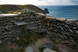 Detail of steps built in to a dry stone wall on the coast of Cornwall