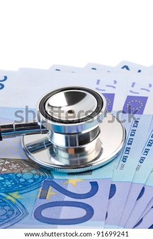 detail of stethoscope on 20-euro banknotes on white background