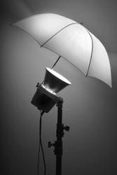 Detail of studio flash strobe light and umbrella on stand strobist professional photographer