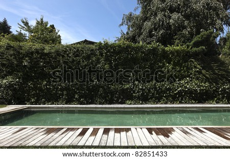 detail of swimming pool with views, summer day - stock photo