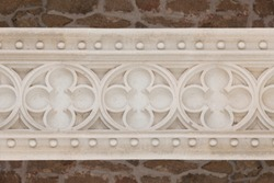 Detail of symbols carved in stone in the castle of Manzanares el Real, Madrid.