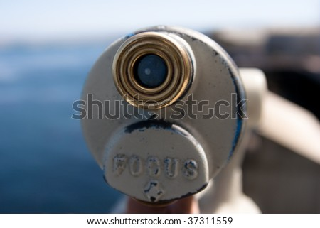 Detail of telescope with soft focus background - stock photo