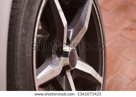 Detail of the alloy wheel of a car wheel #1361073425