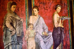detail of the ancient painting in the Villa of the Mysteries in Pompeii.