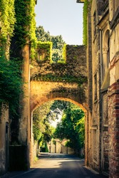 Detail of the ancient walls of the village of Asolo illuminated by the sun and entrance door called Loreggia, Treviso, Italy