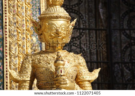 Detail of the architecture, figure fragment of Buddhist temples. Typical traditional sculpture of The Grand Palace in Bangkok Metropolis, Thailand.