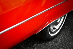 Detail of the back wheel of a vintage red car