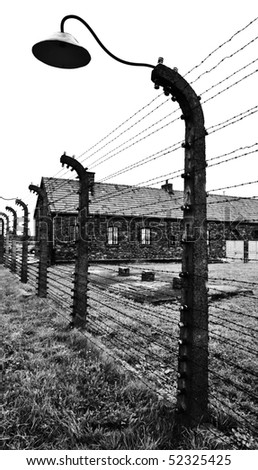 detail of the barbed fence with lamp in concentration camp in poland
