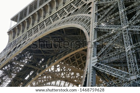Detail of the basis of the Eiffel Tower and of the first floor, in Paris