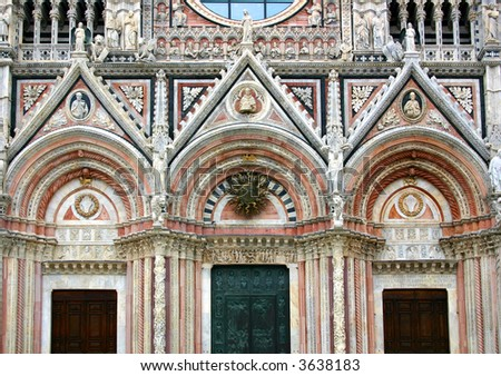 Detail of the beautiful and rich facade of the cathedral of Siena, the beautiful town in Tuscany, Italy