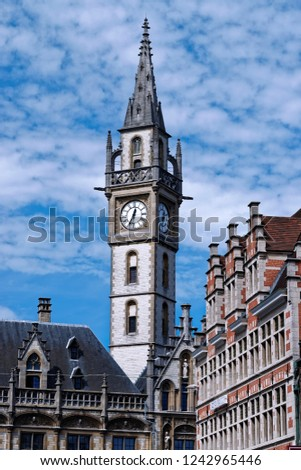 Detail of the clock tower of the former Post office building (build 1909) in Ghent Belgium, now a shopping center and luxurious hotel.