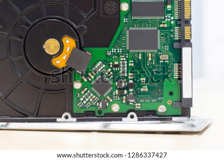 Detail of the electronic board of a mechanical hard disk, of a personal computer #1286337427