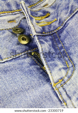 Detail of the front of a worn pair of blue jeans.