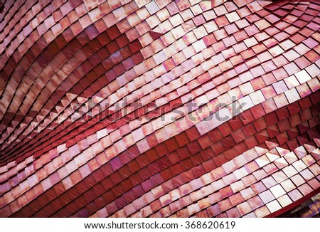 Detail of the futuristic red roof of the exhibition pavilion. Architectural element.