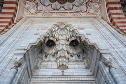 Detail of the gate of Selimiye Mosque in Edirne, Turkey. The mosque is in UNESCO World Heritage Site. The mosque was commissioned by Sultan Selim II, and was built by architect Mimar Sinan