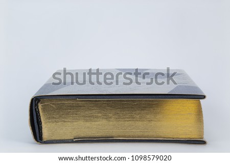 Detail of the gold edging of an old book.